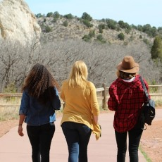 Photograph of three women walking
