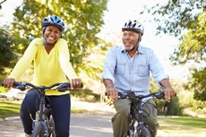 Photograph of two people riding bikes