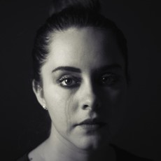 Photograph of a woman crying