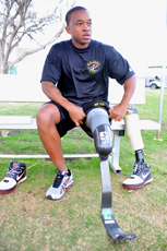 A photograph of a male athlete with a leg prosthesis