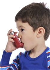 Photograph of a boy using an inhaler