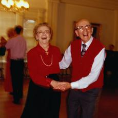 Photograph of a senior man and woman dancing