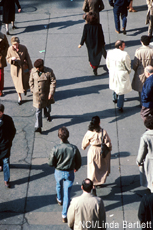 Photograph of several people walking outdoors