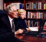 Color photo of Dr. Donald A.B. Lindberg and grandson at computer