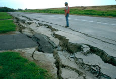Photograph of road damage from an earthquake