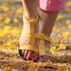 A photo of a woman walking in sandals