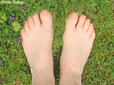 A photo of feet in the grass