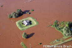 Photograph of a house surrounded by flood water