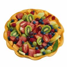 Photograph of a bowl of cut fresh fruit