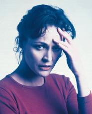 Photograph of a woman with a headache