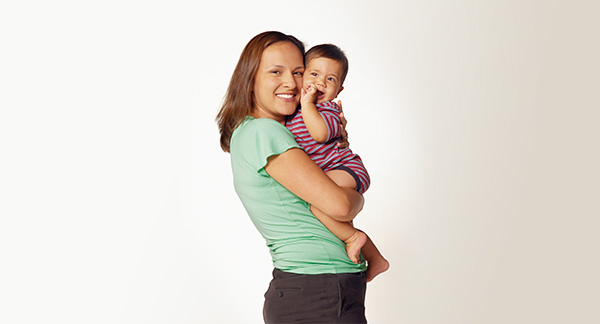 A photograph of a woman holding a baby