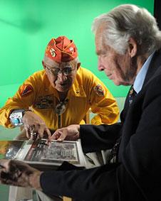 Dr. Lindberg & veteran looking at a document.