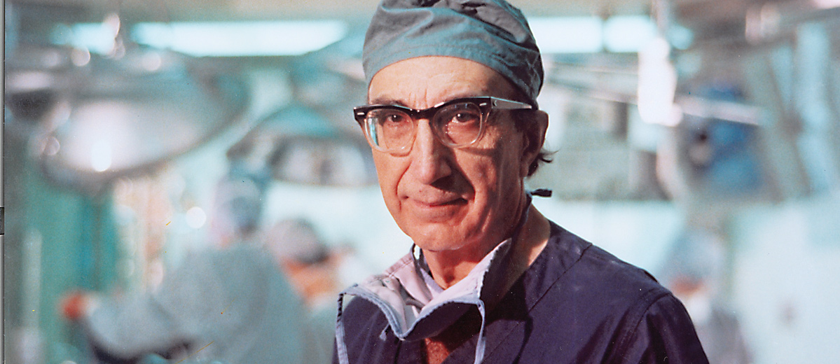 DeBakey in an operating room dressed in surgical attire