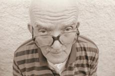 Photograph of a senior man with glasses