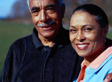 A photograph of a man and a woman smiling