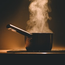 A photograph of a pot on a stovetop
