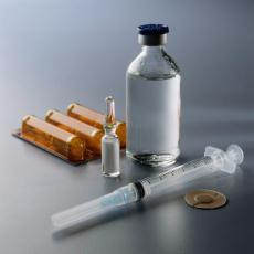 Photograph of a medicine bottle and a syringe