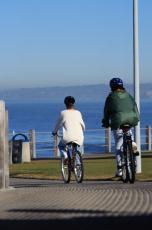 Photograph of two women riding bikes